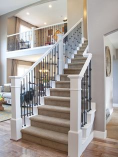 Staircase Design Inspiration, Pictures and Remodels Traditional Staircase Wrought Iron Stairs Design, Pictures, Remodel, Decor and Ideas – white with iron rails Wrought Iron Stair Railing, Staircase Railings, Banisters, Staircase Design, Iron Spindles, Stairway Railing Ideas, Rod Iron Railing, Wood Railing, Stair Design