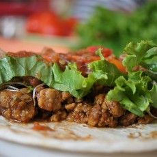 Tempeh Taco Filling 1 pound plain tempeh 1 tablespoon chili powder 1 tablespoon olive oil 3 cloves fresh garlic, minced 1/4 cup water 2 tablespoons tamari Pinch of pepper