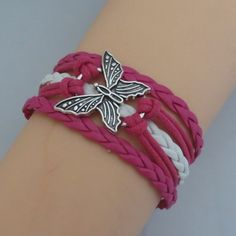 Butterfly Bracelet✨5 available✨ Great bracelet on pink cords! This bracelet measures about 7 inches plus it has an additional chain extender on the back. New in package. Jewelry Bracelets