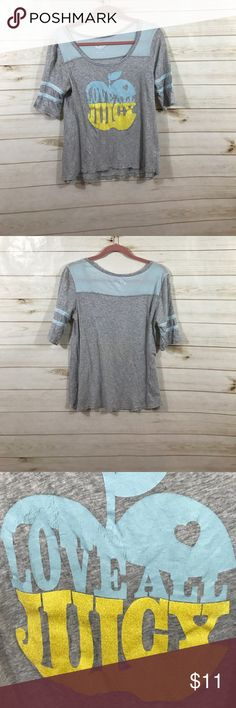 Juicy short sleeve t shirt size Large Juicy short sleeve t shirt size Large. Used and a little faded on the top of the front logo, as pictured. Juicy Couture Tops Tees - Short Sleeve
