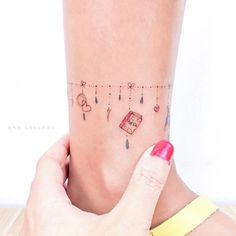 Charm anklet tattoo by Ana Abrahao