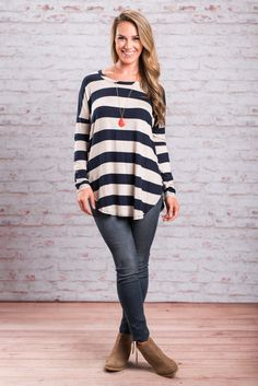 It's no surprise that you love this tunic! You've always loved this style so why wouldn't you love it in stripes too?! This navy and gray tunic is just what you need for casual days just running around town! It's soft jersey knit fabric will keep you comfy while it's style will keep you looking fab!