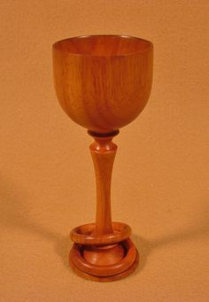 "Lathe turned wedding goblet with two captured rings.  The wood is jobilla.  The goblet is 5"" tall and 2"" in diameter.  The rings cannot be removed without breaking them or the goblet signifying the strong bond of the married couple."