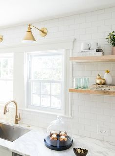 White Kitchen with Delta Trinsic Deck Mount Pull Down Faucet in Champagne Bronze | Subway tile and brass in a kitchen
