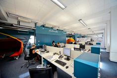 Open plan office coordinated with blue and orange color. #openplanoffice Cubicles.com