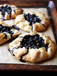 Blueberry Galettes Recipe on YummlyThese galettes are mini, rustic and filled with fresh blueberries. They're a must for your summer baking list!Bundles of fresh blueberries baked in a pocket of buttery pastry. Mini Desserts, Just Desserts, Delicious Desserts, Yummy Food, Healthy Fruit Desserts, Tasty, Summer Desserts, Tart Recipes, Baking Recipes
