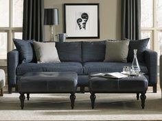 Chic Denim sofa with navy leather gray walls, black/white accents