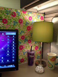 Cute lamp in the corner matches my wrapping paper wallpaper.  Cubicle Ideas. Cubicle Decorations.