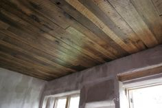 Refurbished barn board ceilings at DachaProject.com. They were grey when we found them. We sanded them down, and linseed oiled them up.  The boards were all different widths and lengths and it took some jigsaw work to put them up. Totally worth the time!