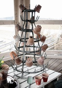 pots on bottle drying rack