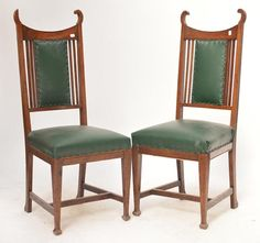 A pair of oak Art Nouveau dining chairs with upholstered stuffover seats and square sectioned legs #ukauctioneers #artnouveau #antiquehour