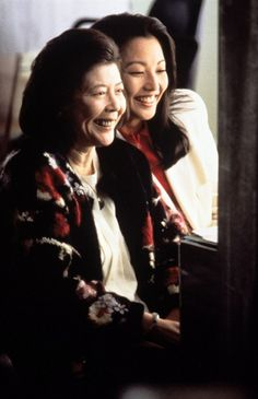 "Picture of Movie ""The Joy Luck Club (1989)"" Directed by Wayne Wang. Screenplay by Amy Tan, Ronald Bass. Consists of sixteen interlocking stories about the lives of four Chinese immigrant mothers and their four American-born daughters. In 1949, four mothers meet at the First Chinese Baptist Church in San Francisco and agree to continue to meet to play mah jong. Structurally, the novel is divided into four major sections, with two sections focusing stories of the mothers and two sections on…"