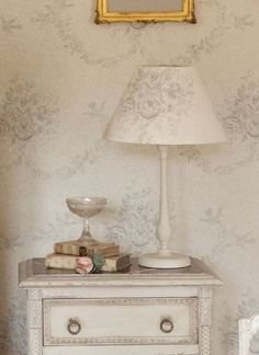 Kate Forman -  Kate Forman Fabric Collection - Classic white lamp shade with light grey flower design and fabrc wall paper with a classic faint grey flower pattern
