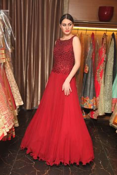 Lady in red, gown by #RamanKhanna - available in-store at O'nitaa #London