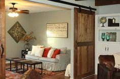 Inviting den. Like the barn doors (Fixer Upper | Season 1 Episode 11 | The Crawford House)