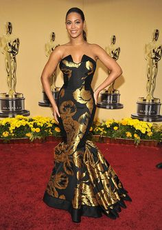 In 2009, Beyonce represented her own line when she wore this black and gold House of Dereon mermaid gown.