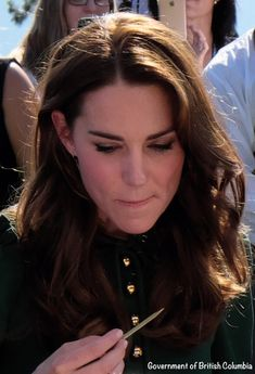 Catherine, Duchess of Cambridge samples Indian food cooked by Vikram Vij at Mission Hill Winery on September 27, 2016 in Kelowna, Canada.