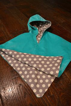 poncho pattern - with hood. back can be flipped up to go into carseat without having to put coat on and off.