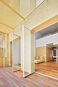 Sunny yellow surfaces feature extensively throughout Duplex in Sant Gervasi, which has been refreshed by Barcelona-based studio Arquitectura-G. Duplex Apartment, Apartment Renovation, Apartment Interior, Interior Walls, Nook Architects, Floor Slab, 2nd Floor, Barcelona Apartment, Yellow Tile