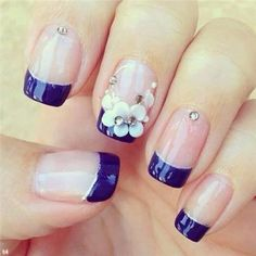 Nail polish: blue tip nail Not crazy about the blue, the flowers however.. ooh la la