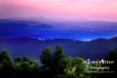 Asheville, NC. Amazing sunsets...they really look like this. Great B&B's and rental houses with mountain views.