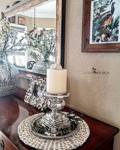 Reflections on a Sunday. A day to reflect and be thankful. Pottery Barn candle holder and place mat, Mudpie oyster shell frame, Anthropologie mercury glass vase, Michaels Stores florals.