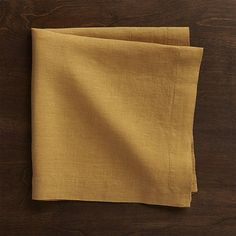"""Lightweight 100% linen dinner napkin unfolds to a generous 22"""" square in golden amber, pre-washed for extra softness. Tailor finished with a 1.5"""" hem and mitered corners."""