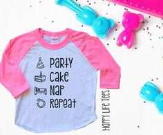 """Your little girl is turning ONE years old! Let her celebrate in style with this playful and funny t-shirt created just for him. Featuring the phrase, """"PARTY CAKE NAP REPEAT!"""" your little one will be s"""