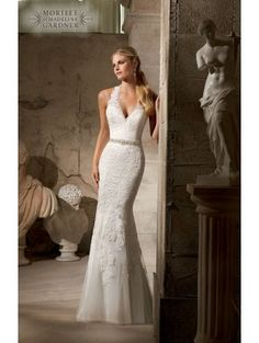 Loving the key hole back on this Mori Lee Wedding dress