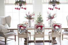 wreaths on chair backs/ornaments and greenery on light fixtures - fun!