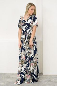 Can't you just see the flowers blooming in the sunlight as you wear this visionary maxi dress. I know I see the blossoming flowers on this maxi dress! This navy dress features butterfly sleeves, ribbo