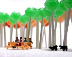 mini people under a forest of lollies