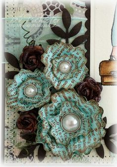 Shabby chic flowers from old book pages - I like the colors used