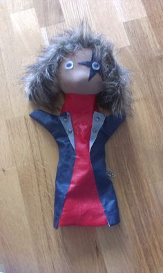 Paul Stanley puppet. Made from old clothes. The face is a stocking with cotton inside, and a big bead for nose. The clothes are made from an old raincoat. And the hair is made from the fur from the collar on an old winterjacket. MN