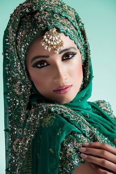 Indian bride in beautiful emerald green wedding dress