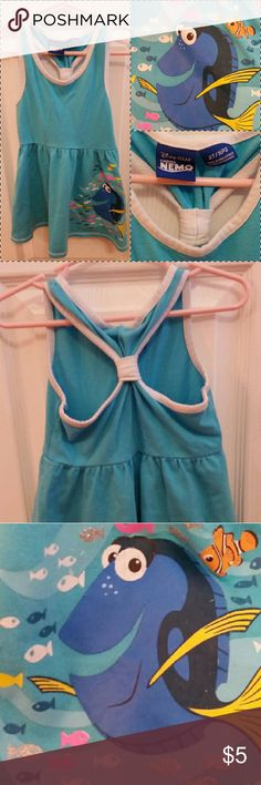 Finding Dory Dress Racer back style GUC Adorable blue little dress in good used condition one tiny light stain so minor I had a difficult time trying to photograph, can slightly see in last photo, price reflective.  Cute for everyday play or as a beach/pool cover-up.  (Consider bundling to get more value out of the cost of Shipping and feel free to make offers on bundles) Thank you for visiting my closet!! SMOKE FREE CLEAN HOME Disney Dresses Casual