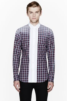 DSQUARED2 //  Navy plaid wired collar contrast bib shirt  32148M040001  Long sleeve shirt in navy, red, and white. Plaid pattern throughout. White spread collar with internal wire supports. Button closure at front with contrasting button placket in white. Faded effect at shoulders and elbows. Shirttail hem. Tonal stitching. Single-button barrel cuffs with internal wire supports. 100% cotton. Machine wash cold. Made in Italy.  $560 CAD