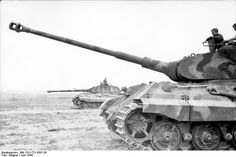 s.Pz.Abt. 503, Tiger II 322 and 324 behind it at initial gunnery exercises at Ohrdruf Training Area, Germany, June 1944.