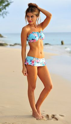 A flirty little swim suit just in time for summer! Bandu top with ruffle skirt in a floral print.