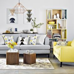 Yellow and grey living room with geometric prints