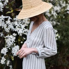 "The ""Bennet"" dress is arriving in the shop today! Soft lightweight cotton in grey against off white stripes. This dress features feminine silhouette, easy to wear and comfortable, and in a classic color and print that will never go out of style. Comment if you want a tag when she's online!"