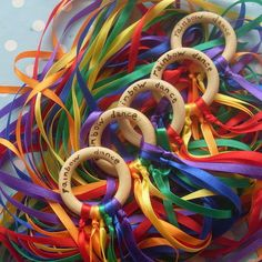 cool idea to make for the preschool - rainbow dance wooden rainbow ring