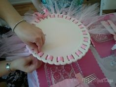 How to dazzle up a cake stand with some tulle and ribbon! http://www.missmaesdays.com/baby-shower-on-a-budget/