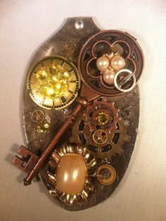Sterling Silver Plated Spoon Steampunk Style adorned with watch parts, vintage jewelry pieces and other embellishments.