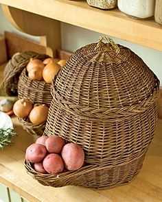 Keep Your Potatoes and Onions in Old World Vegetable Baskets Plastic grocery bags retain moisture, speeding the demise of potatoes and onions. These breathable woven baskets, used for centuries in Europe, are a better solution. They fill from the top, and dispense vegetables from the pocket below. And they add a little country style to your kitchen or pantry. Set of two; large holds about 30 lbs. of potatoes, small holds about 6 lbs. of onions. Hand-woven willow with braided sea grass…