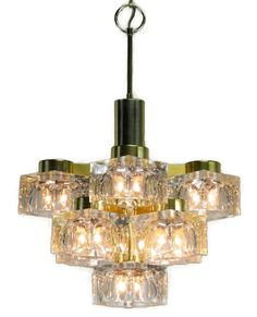 Beautiful vintage Lightolier chandelier with cubic glass blocks for the Hollywood Regency Lighting look for a mad men decor. This vintage chandelier is sure to light up a room! Classic mid century modern chandelier with ice block glass with bubbles and a brass frame by Italian designed Gaetano Sciolari for the Lightolier Company. Different number of cubes where proposed for various style adaptation. Starting when wall sconces declined in 2 , 4 or 5 cubes, up to a rarely seen, massive 57…
