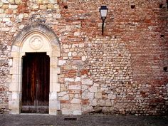Moissac, France.  Old church wall.  Rebuilt several times.  Weathered door.  2006