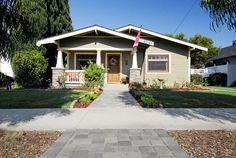This is California craftsman bungalow -- normally porch roof sticks out further than other pitched roof