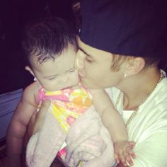"Throwback Bieber on Twitter: ""Justin holding a baby in Miami ..."