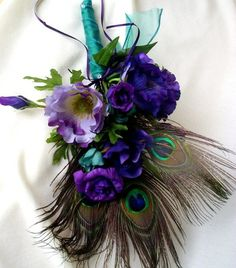 Purple-dominated bouquet with lime accents, teal and peacock feathers